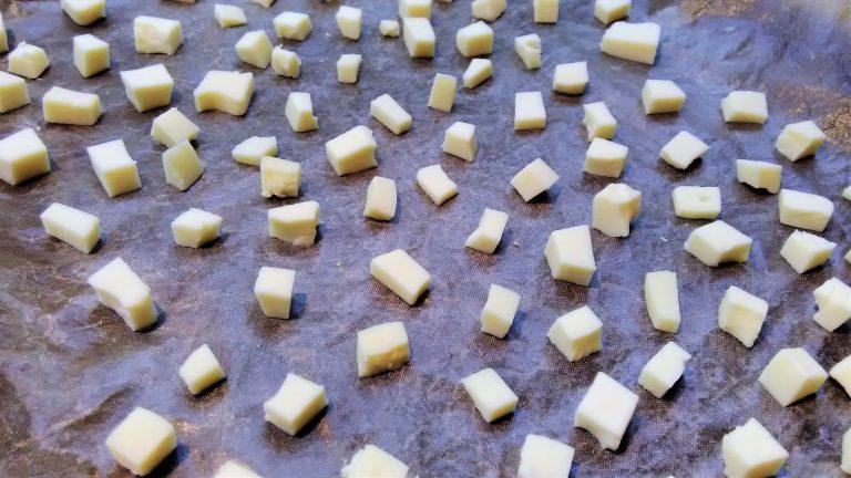 Gouda cheese on baking tray