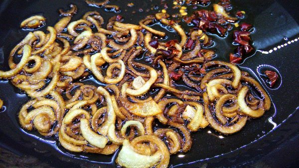 Frying onion rings and chillies
