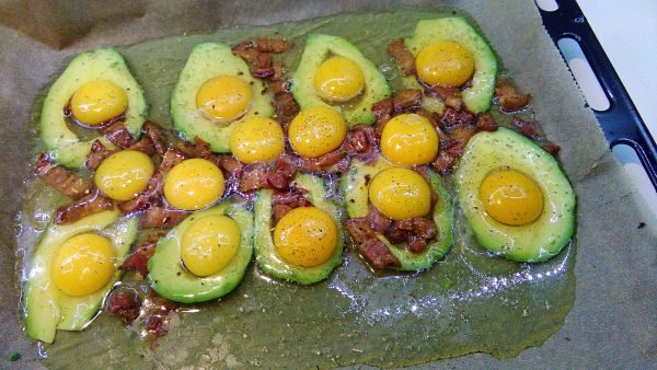 Raw Eggs And Avocado on Tray